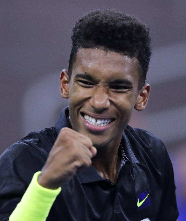 FILE - In this Aug. 27, 2019, file photo, Felix Auger-Aliassime, of Canada, pumps his fist after winning a point against Denis Shapovalov, of Canada, during the first round of the U.S. Open tennis tournament in New York. Of particular interest is when a new face will emerge from the crop of 20-somethings who have been rising in the rankings. (AP Photo/Charles Krupa, File)
