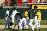 Oakland Athletics players celebrate defeating the Houston Astros after a baseball game in Oakland, Calif., Sunday, Sept. 26, 2021. The Athletics won 4-3. (AP Photo/John Hefti)