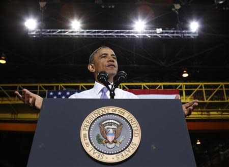 U.S. President Barack Obama speaks about the economy during a visit to ArcelorMittal steel mill in Cleveland, Ohio November 14, 2013. REUTERS/Kevin Lamarque (