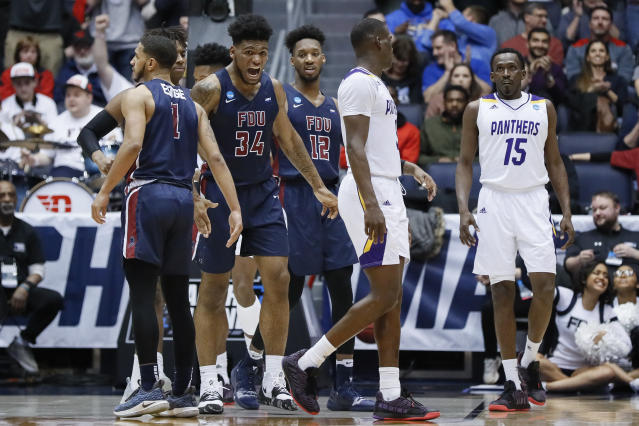 Fairleigh Dickinson's Mike Holloway Jr. (34) reacts after scoring and taking the lead alongside Prairie View A&M's Gerard Andrus (15) during the second half of a First Four game of the NCAA college basketball tournament, Tuesday, March 19, 2019, in Dayton, Ohio. (AP Photo/John Minchillo)
