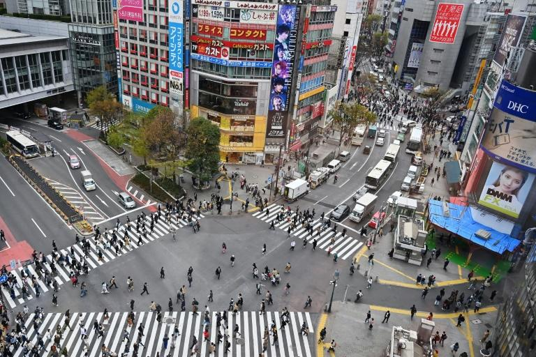 Pedestrians stroll the Shibuya crossing in Tokyo, where fears are high of cyber attacks