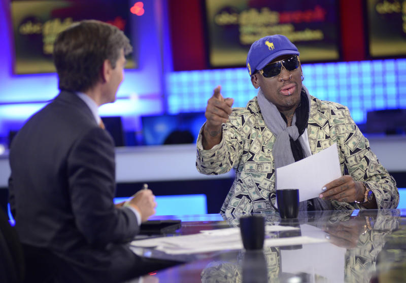 "In this Sunday March 3, 2013, photo provided by ABC television ""This Week"" host George Stephanopoulos, left, interviews former NBA star Dennis Rodman, just back from a visit with North Korea's young leader Kim Jong Un, in studio in New York. Kim Jong Un doesn't really want war with the superpower, just a call from President Barack Obama to chat about their shared love of basketball, says erstwhile diplomat Rodman.""He loves basketball. ... I said Obama loves basketball. Let's start there"" as a way to warm up relations between U.S. and North Korea"", Rodman  said.  (AP Photo/ABC Television, Lorenzo Bevilacqua)"