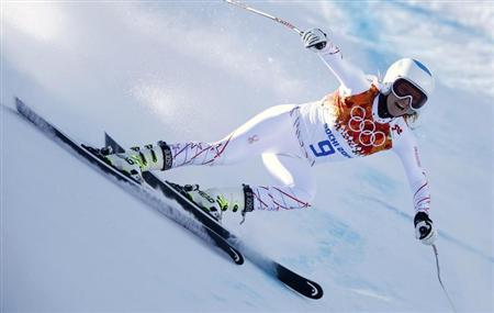 Mancuso of the U.S. speeds down the course in the first training session for the women's alpine skiing downhill event during the 2014 Sochi Winter Olympics at the Rosa Khutor Alpine Center