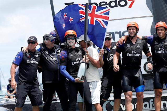 Sailing - America's Cup finals - Hamilton, Bermuda - June 26, 2017 - Peter Burling, Emirates Team New Zealand Helmsman celebrates with his team after defeating Oracle Team USA in race nine to win the America's Cup. REUTERS/Mike Segar