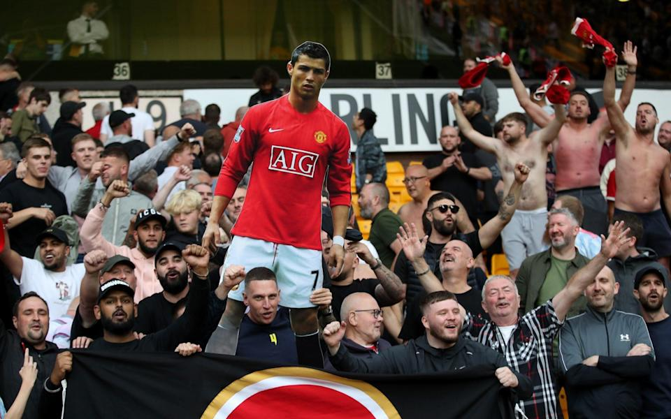 Manchester United fans celebrate with a cardboard cut out of Cristiano Ronaldo - Reuters