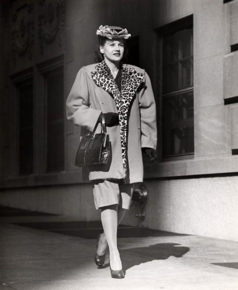 <p>Shoulder pads make their fashion debut on this coat and skirt set. And of course, more leopard print. </p>
