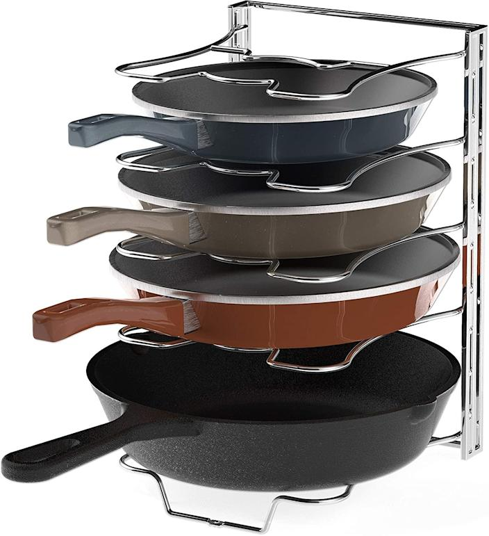 SimpleHouseware Kitchen Cabinet 5 Adjustable Compartments Pan and Pot Lid Organizer Rack Holder. (Image via Amazon)