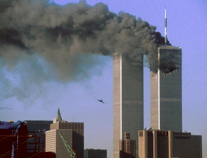 Hijacked United Airlines Flight 175 (L) flies toward the World Trade Center twin towers shortly before slamming into the south tower (L) as the north tower burns following an earlier attack by a hijacked airliner in New York City September 11, 2001. (Reuters)