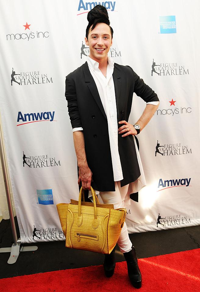 Surprisingly, Johnny Weir's mustard-hued man purse doesn't bother us. The fabulous figure skater's topknot, on the other hand, has got to go! Not even Tonya Harding would be seen rocking such a disastrous 'do. (4/8/2013)