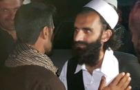 A newly freed Taliban prisoner greets his relatives outside Bagram prison, north of Kabul