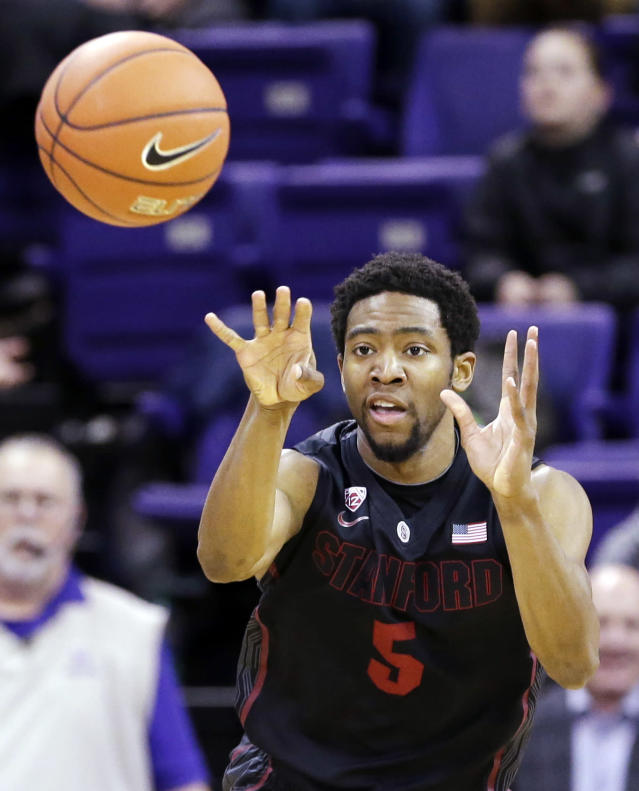 Stanford's Chasson Randle passes against Washington in the first half of an NCAA college basketball game Wednesday, Feb. 12, 2014, in Seattle. (AP Photo/Elaine Thompson)