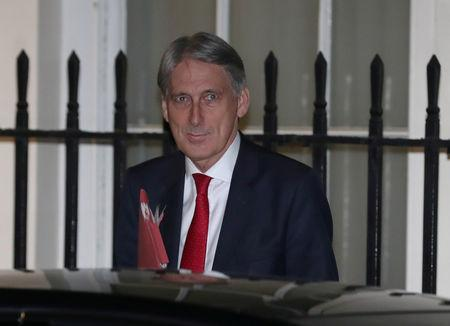 Britain's Chancellor of the Exchequer Philip Hammond leaves 11 Downing Street in London, Britain, November 13, 2018. REUTERS/Simon Dawson