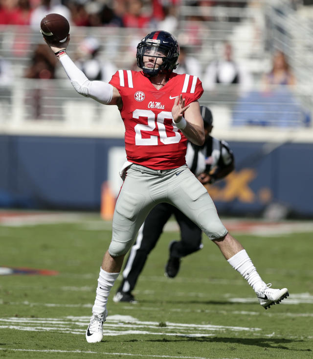 File-This Oct. 14, 2017, file photo shows Mississippi quarterback Shea Patterson (20) passing against Vanderbilt in the first half of an NCAA college football game in Oxford, Miss. Michigan is unlikely to know whether Mississippi transfer Patterson will be eligible to play next season by the time it begins spring practice March 23. Attorney Tom Mars, who is advising Patterson, says an NCAA ruling cannot come until after Ole Miss has the opportunity to respond to Michigans application for a waiver. (AP Photo/Rogelio V. Solis, File)