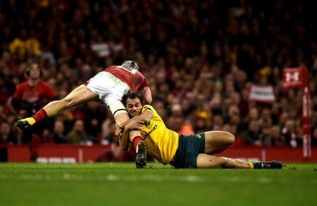 FILE PHOTO: Rugby Union - Autumn Internationals - Wales vs Australia - Principality Stadium, Cardiff, Britain - November 11, 2017 Wales' Jonathan Davies is tackled by Australia's Karmichael Hunt. REUTERS/Rebecca Naden
