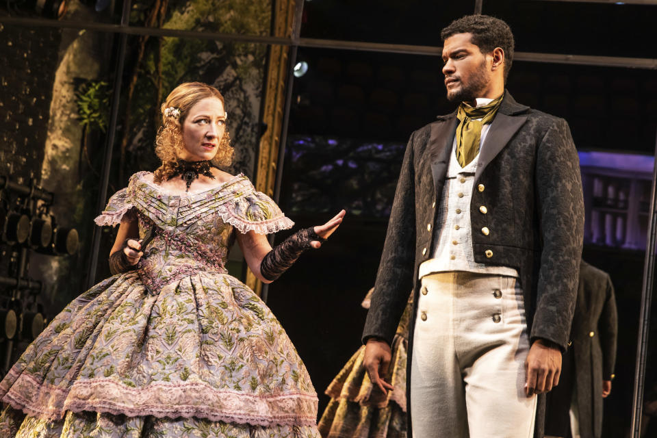 "Annie McNamara, left, and Sullivan Jones wear costumes designed by Dede Ayite during a performance of ""Slave Play"" in New York. Ayite has earned two 2021 Tony Award nominations for costume design, one for ""Slave Play"" and another for ""A Soldier's Story."" (Matthew Murphy/DKC O&M Co. via AP)"