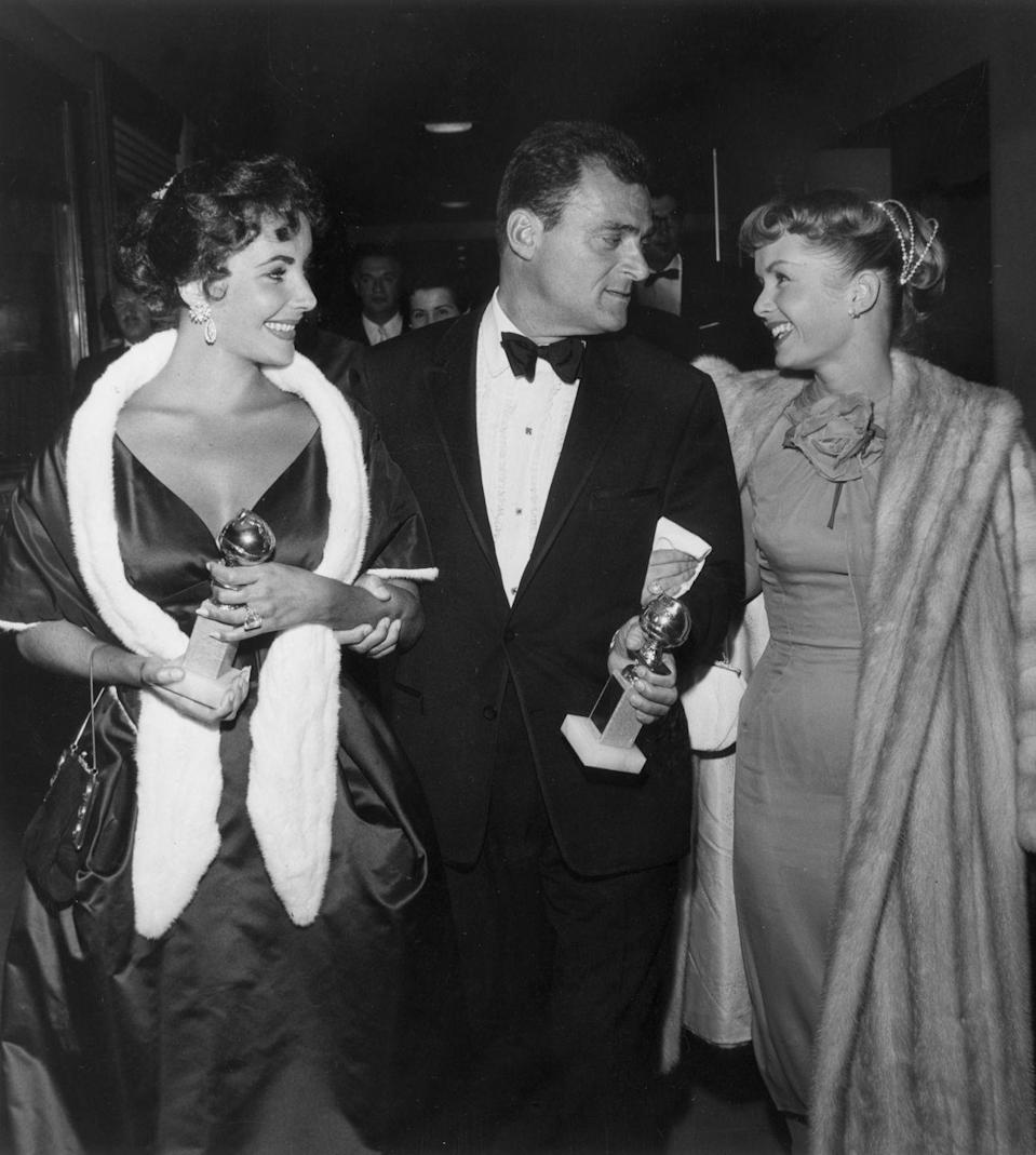 """<p>The complicated relationship between these two Hollywood icons started with an <a href=""""https://www.biography.com/news/elizabeth-taylor-eddie-fisher-debbie-reynolds-affair"""" rel=""""nofollow noopener"""" target=""""_blank"""" data-ylk=""""slk:infamous love triangle"""" class=""""link rapid-noclick-resp"""">infamous love triangle</a>, when Debbie Reynolds's husband, Eddie Fisher, walked out on her for none other than Debbie's longtime friend, Elizabeth Taylor. Reportedly, Eddie and Elizabeth's affair first started when Eddie attempted to comfort Elizabeth after her husband, Mike Todd, unexpectedly passed away in 1959 ... only for them to fall in love.</p>"""