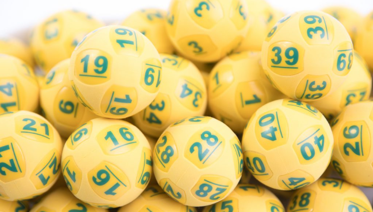 Oz Lotto balls shown as officials call on $50 million division one winner to come forward.