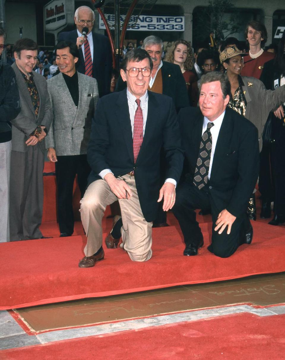 <p>Leonard Nimoy and William Shatner, along with the cast of <i>Star Trek,</i> leave their handprints on Dec. 5, 1991, coinciding with the release of <i>Star Trek VI</i>. <i>(Photo: BEImages)</i></p>
