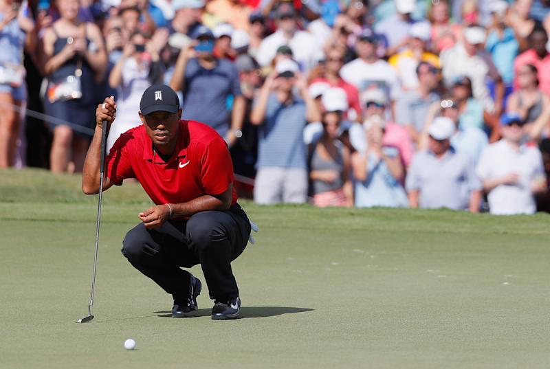 ATLANTA, GA - SEPTEMBER 23: Tiger Woods of the United States lines up a putt on the ninth green during the final round of the TOUR Championship at East Lake Golf Club on September 23, 2018 in Atlanta, Georgia. (Photo by Kevin C. Cox/Getty Images)