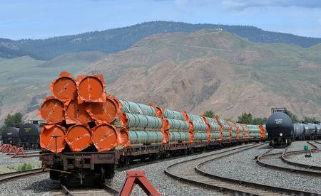 Steel pipe to be used in the pipeline construction of Kinder Morgan Canada's Trans Mountain Expansion Project sit on rail cars at a stockpile site in Kamloops