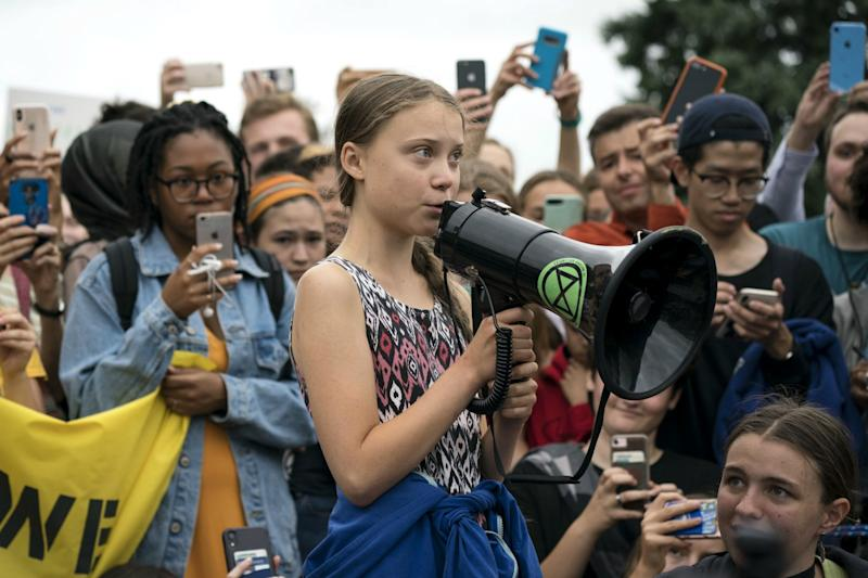 Swedish youth climate activist Greta Thunberg delivers brief remarks surrounded by other student environmental advocates during a strike against climate change outside the White House on September 13, 2019 in Washington, DC. (Photo by Sarah Silbiger/Getty Images)