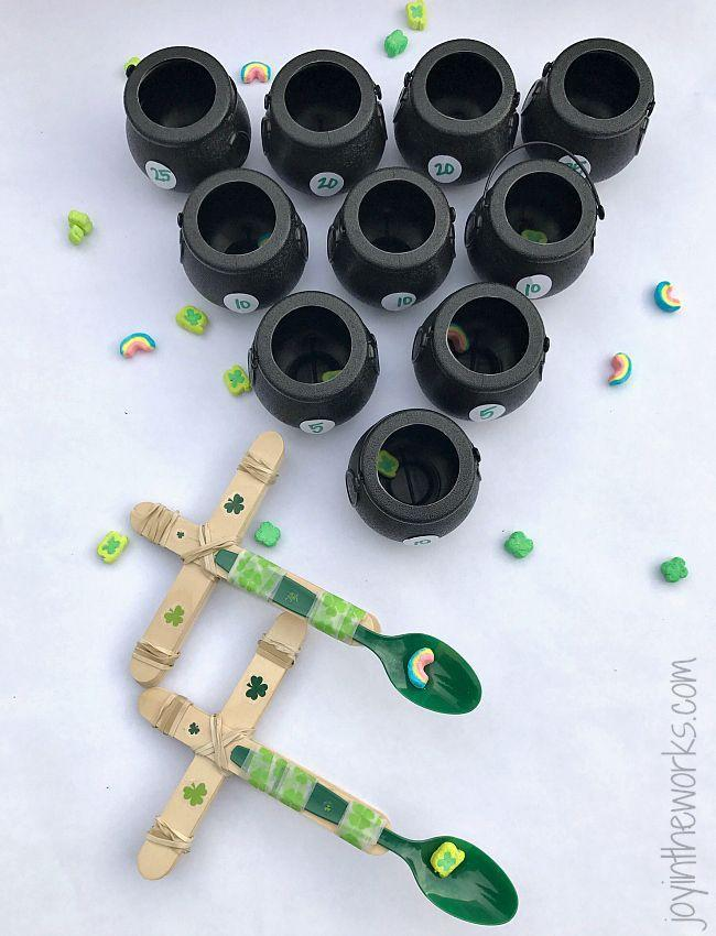"""<p>Let your kids' imaginations run wild crafting their own catapults. </p><p><strong>Get the tutorial at <a href=""""https://www.joyintheworks.com/lucky-charms-catapults-for-st-patricks-day/"""" rel=""""nofollow noopener"""" target=""""_blank"""" data-ylk=""""slk:Joy in the Works"""" class=""""link rapid-noclick-resp"""">Joy in the Works</a>.</strong></p><p><strong><a class=""""link rapid-noclick-resp"""" href=""""https://www.amazon.com/dp/B07BDR47G7?tag=syn-yahoo-20&ascsubtag=%5Bartid%7C10050.g.26234489%5Bsrc%7Cyahoo-us"""" rel=""""nofollow noopener"""" target=""""_blank"""" data-ylk=""""slk:SHOP CAULDRONS"""">SHOP CAULDRONS</a><br></strong></p>"""