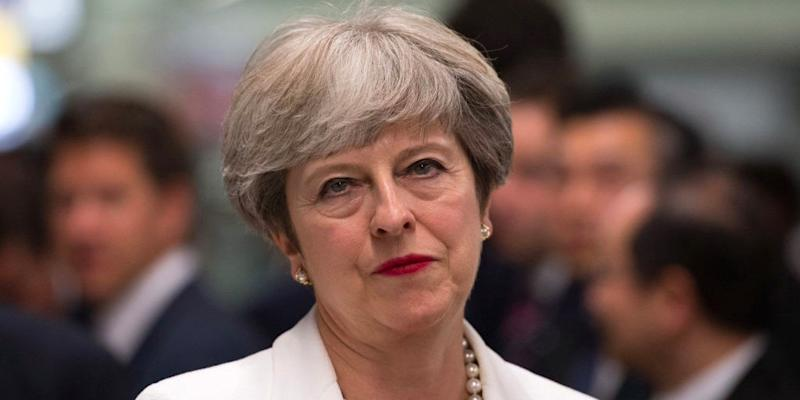 May reins in Tory rebels with fear of reshuffle