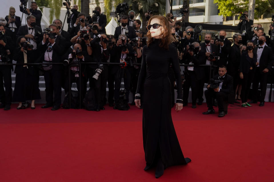 FILE - In this July 7, 2021 file photo Isabelle Huppert poses for photographers upon arrival at the premiere of the film 'Everything Went Fine' at the 74th international film festival, Cannes, southern France. (AP Photo/Brynn Anderson, File)