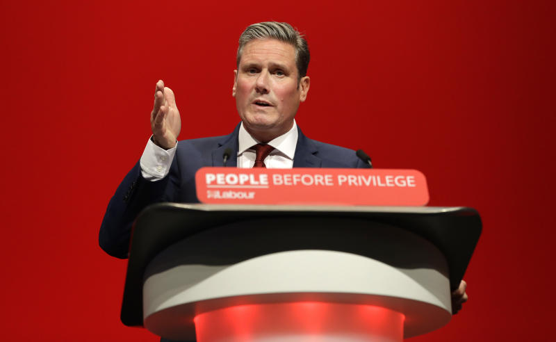 FILE - In this Monday, Sept. 23, 2019 file photo, Britain's Shadow Brexit Secretary Keir Starmer speaks on stage during the Labour Party Conference at the Brighton Centre in Brighton, England. On Friday, Nov. 8, 2019, The Associated Press reported on an altered video circulating online incorrectly asserting Starmer was too stumped to answer a question about the EU deal. The footage was intentionally altered and posted by British Prime Minister Boris Johnson's Conservatives onto social media on Nov. 5. (AP Photo/Kirsty Wigglesworth)