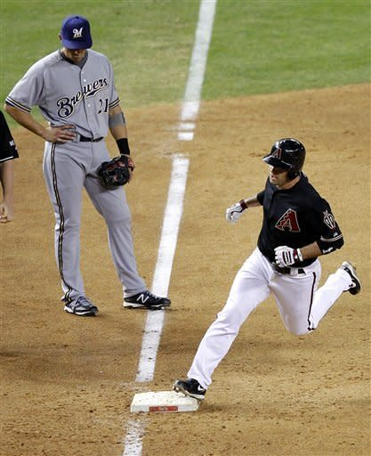 Milwaukee Brewers' Cody Ransom looks downward as Arizona Diamondbacks' John McDonald rounds the bases after hitting a three-run home run during the third inning of a baseball game, Saturday, May 26, 2012, in Phoenix. (AP Photo/Matt York)