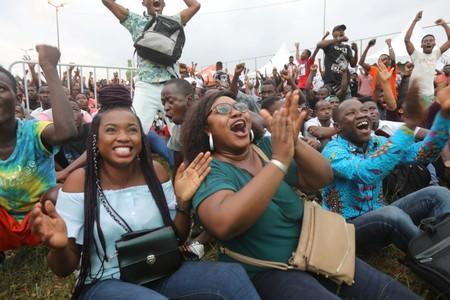 Mariama Doumbia celebrates with Anastasie Makon after Ivory Coast keeper Sylvain Gbohouo stopped a shot for a goal by Mali at the Africa Cup of Nations 2019 (Afcon), as they watch the game on screen in Abidjan