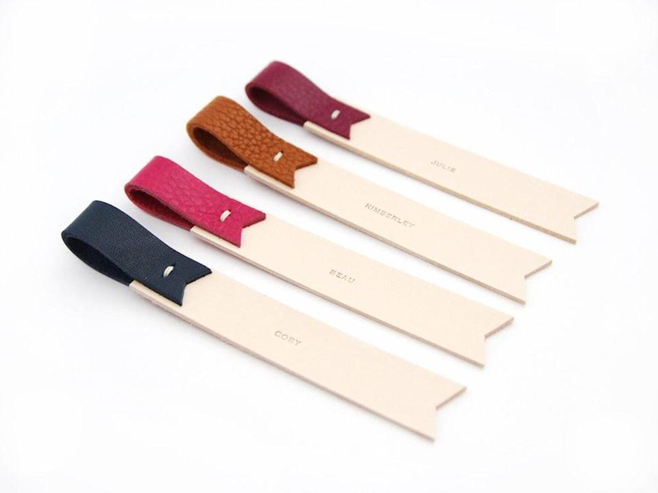 <p>Get a <span>personalized leather bookmark</span> ($14) in a variety of colors. </p>