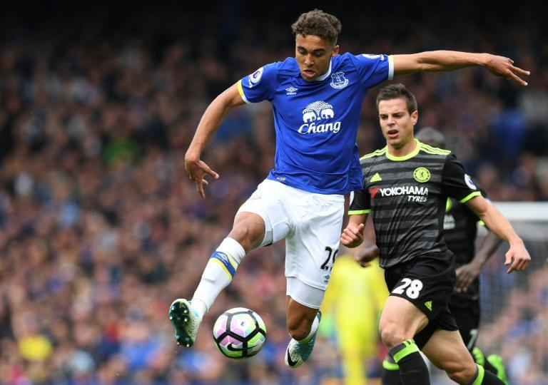 Everton's English striker Dominic Calvert-Lewin (left) controls the ball during the English Premier League match against Chelsea at Goodison Park in Liverpool on April 30, 2017