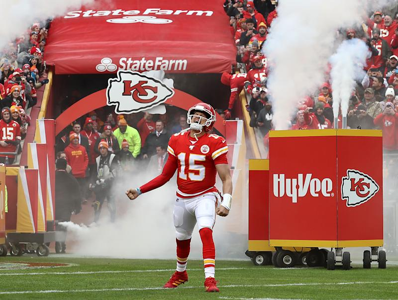 KANSAS CITY, MISSOURI - DECEMBER 29: Quarterback Patrick Mahomes #15 of the Kansas City Chiefs runs out of the tunnel as he is introduced prior to the game against the Los Angeles Chargers at Arrowhead Stadium on December 29, 2019 in Kansas City, Missouri. (Photo by Jamie Squire/Getty Images)
