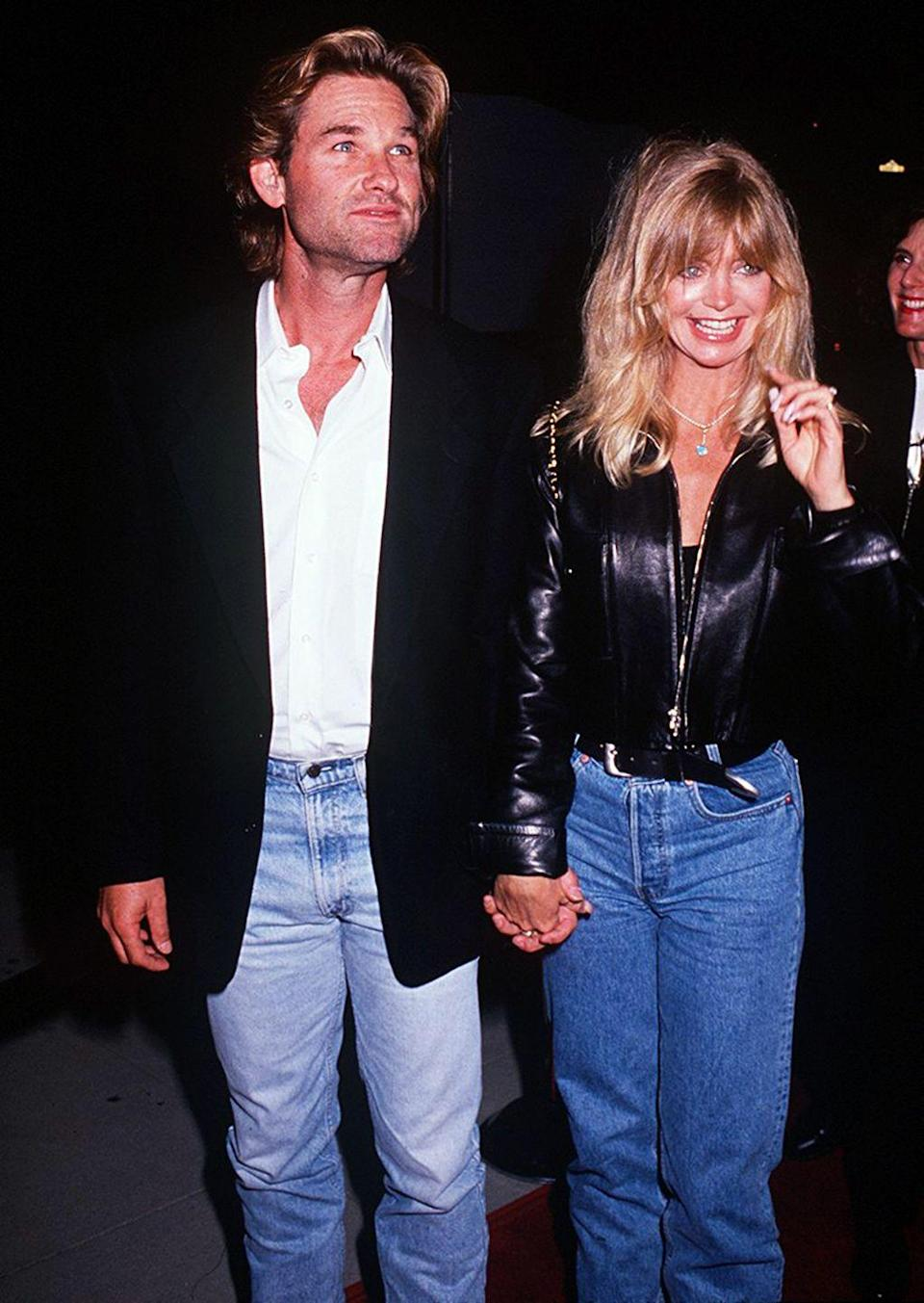 <p>Goldie Hawn keeps the early '90s denim look of choice going strong: The jeans were a lighter or middle-of-the-road shade of blue, the fabric stiff, and the legs straight, never too fitted or skinny.</p>