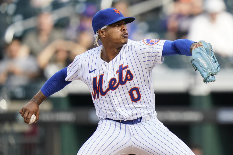 New York Mets' Marcus Stroman (0) pitches during the first inning in the first baseball game of a doubleheader against the Miami Marlins, Tuesday, Sept. 28, 2021, in New York. (AP Photo/Frank Franklin II)