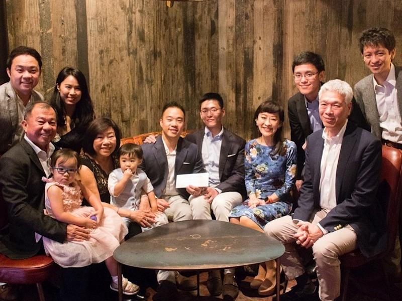 Li Huanwu and his husband Heng Yirui (middle) along with their family members after their wedding in South Africa. PHOTO: Dear Straight People/Facebook