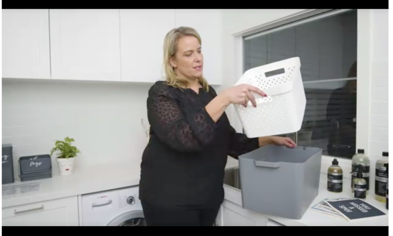 Kmart storage buyer Jess demonstrated her laundry soaking hack. Photo: Kmart.