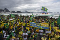 People gather on Copacabana Beach in a demonstration backing President Jair Bolsonaro's anti-coronavirus-lockdown stance, marking May Day, or International Workers' Day, in Rio de Janeiro, Brazil, Saturday, May 1, 2021. Brazil has seen over 400,000 confirmed COVID-19 deaths, a toll second only to the United States. (AP Photo/Bruna Prado)