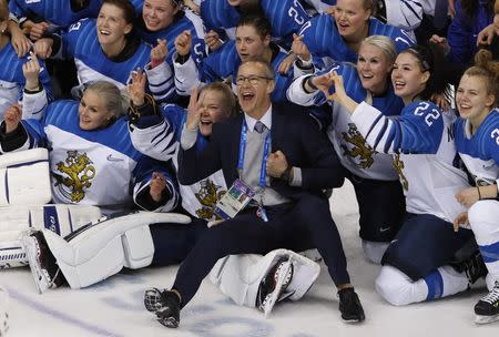 Ice Hockey - Pyeongchang 2018 Winter Olympics - Women's Bronze Medal Match - Finland v Olympic Athletes from Russia - Kwandong Hockey Centre, Gangneung, South Korea - February 21, 2018 - Finland coach Pasi Mustonen celebrates with players after the match. REUTERS/Kim Kyung-Hoon