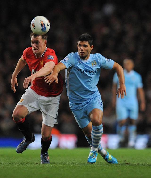 "Manchester United's English defender Phil Jones (L) vies for the ball against Manchester City's Argentinian footballer Sergio Aguero during their English Premier League football match at The Etihad stadium in Manchester, north-west England on April 30, 2012. AFP PHOTO/ANDREW YATES RESTRICTED TO EDITORIAL USE. No use with unauthorized audio, video, data, fixture lists, club/league logos or ""live"" services. Online in-match use limited to 45 images, no video emulation. No use in betting, games or single club/league/player publications.ANDREW YATES/AFP/GettyImages"