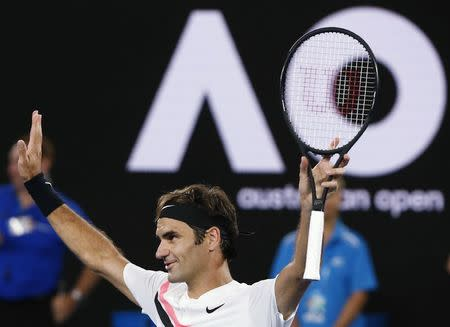 Tennis - Australian Open - Rod Laver Arena, Melbourne, Australia, January 16, 2018. Roger Federer of Switzerland celebrates winning against Aljaz Bedene of Slovenia. REUTERS/Thomas Peter