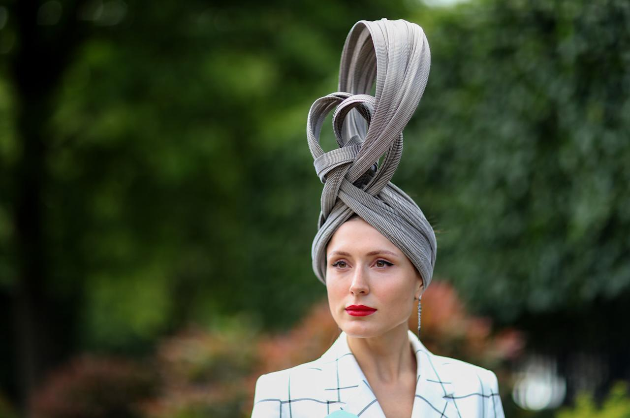 Valerie Stark chose an elegant headpiece for the fourth day to accessorise her checked co-ord. <em>[Photo: Getty]</em>
