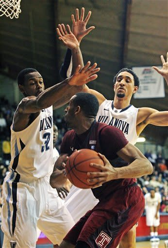 Temple's Rahlir Hollis-Jefferson looks to shoot as Villanova's James Bell (32) and Maurice Sutton, right, defend in the first half of an NCAA college basketball game, Wednesday, Dec. 5, 2012, in Philadelphia. (AP Photo/H. Rumph Jr)