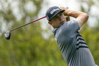 Gary Woodland watches his tee shot on the second hole during the third round of the Wells Fargo Championship golf tournament at Quail Hollow on Saturday, May 8, 2021, in Charlotte, N.C. (AP Photo/Jacob Kupferman)