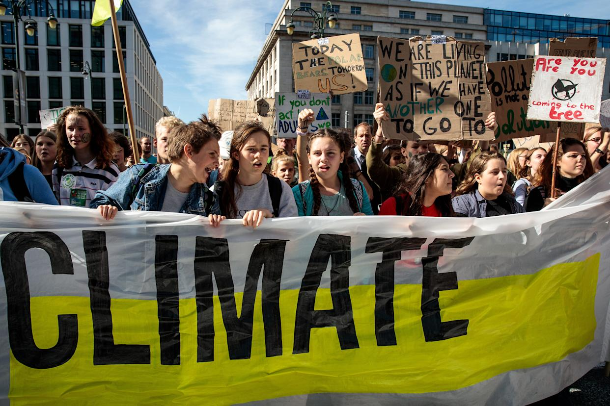 Protesters march through Brussels with placards as they take part in a Global Climate Strike demonstration on Sept. 20, 2019, in Brussels, Belgium.