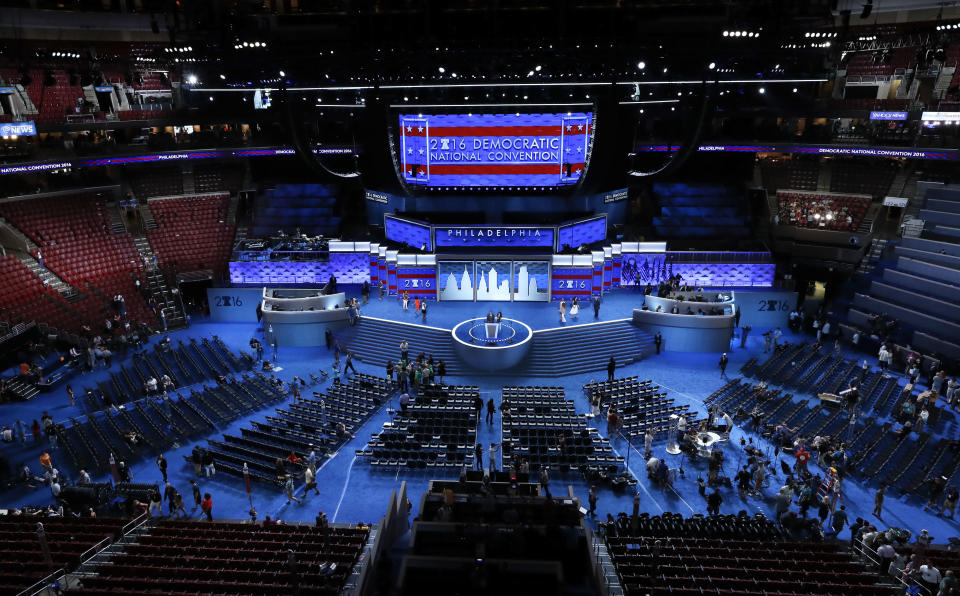 FILE - In this July 24, 2016, file photo, workers prepare for the Democratic National Convention in Philadelphia. Democratic presidential candidate former Vice Presiden JoBiden's presidential nominating convention will highlight the U.S. political spectrum from the left flank of New York Rep. Alexandria Ocasio-Cortez to the Republican old guard of former Ohio Gov. John Kasich. But that doesn't mean there's room for every prominent Democrat who would get a share of the spotlight at a routine convention taking place without the backdrop of a pandemic.(AP Photo/Paul Sancya, File)