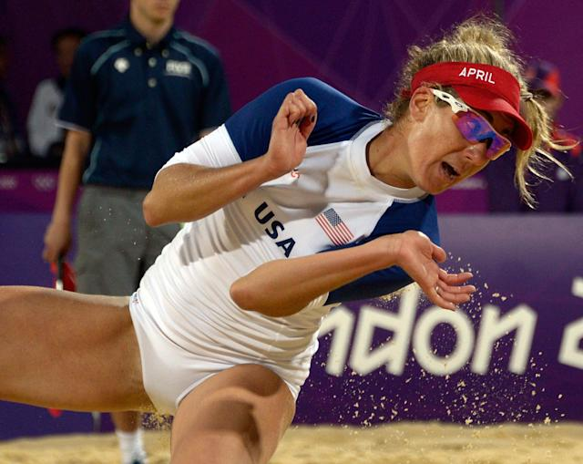 US April Ross looks at the ball during the women's beach volleyball preliminary phase Pool B match against The Netherland's Marleen van Iersel and Sanne Keizer on The Centre Court Stadium at Horse Guards Parade in London on July 31, 2012, during the London 2012 Olympic Games. USA won 2-1 AFP PHOTO / DANIEL GARCIADANIEL GARCIA/AFP/GettyImages