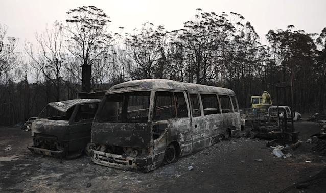 Vehicles gutted by bushfires in Lake Conjola, New South Wales. (Photo by PETER PARKS / AFP) (Photo by PETER PARKS/AFP via Getty Images)