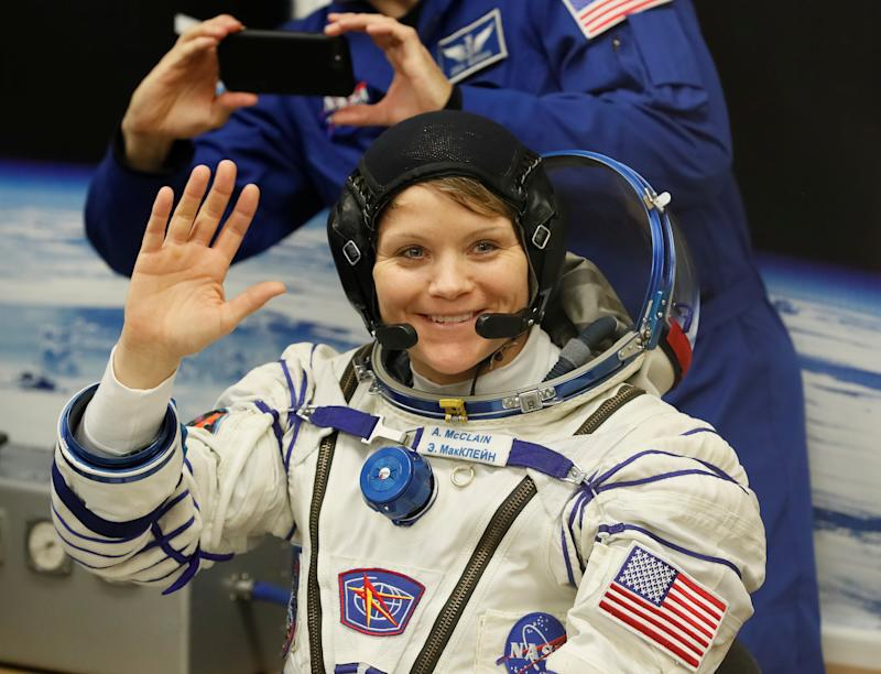 The International Space Station (ISS) crew member Anne McClain of the U.S. waves after donning space suits shortly before their launch at the Baikonur Cosmodrome, Kazakhstan December 3, 2018. REUTERS/Shamil Zhumatov